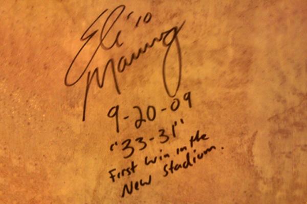 Eli Autographs Cowboys Stadium